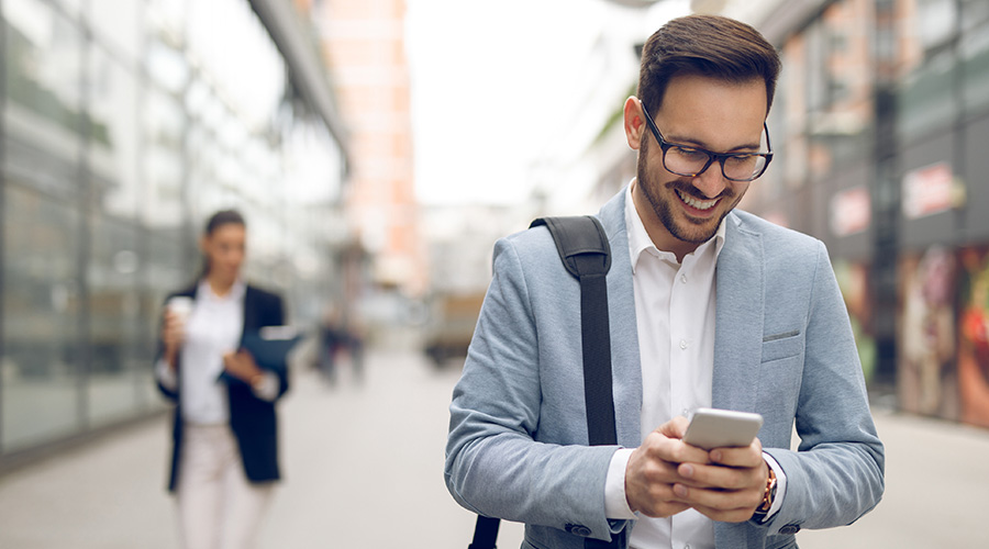 Sales person outdoors on his phone